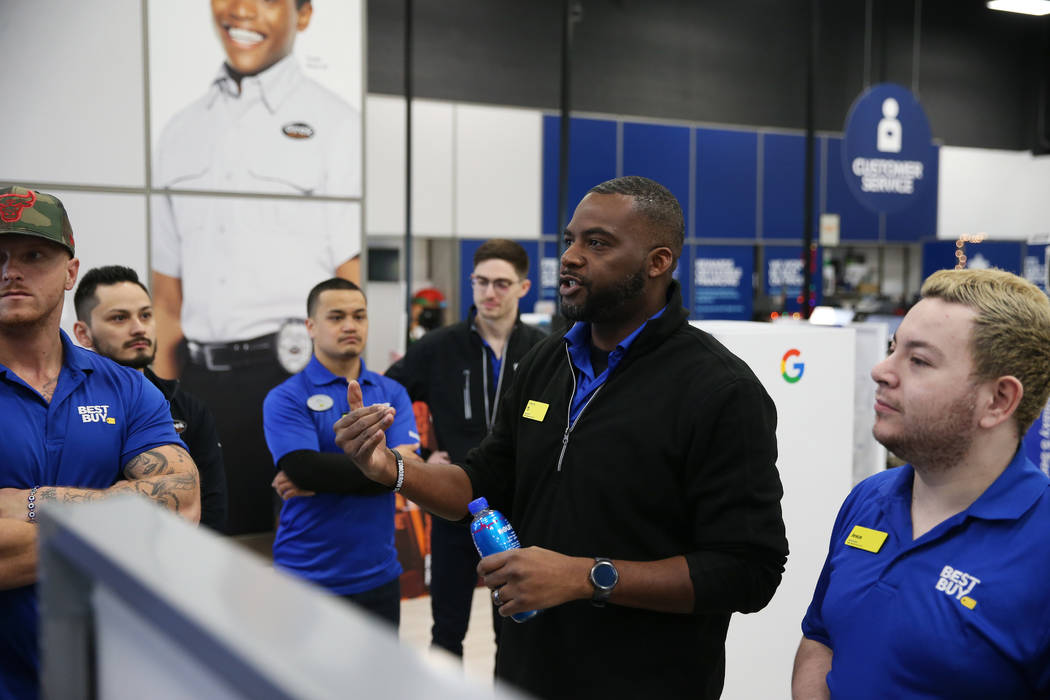 Computer supervisor T.J. Beverly leads employees during a training in preparation of Black Frid ...