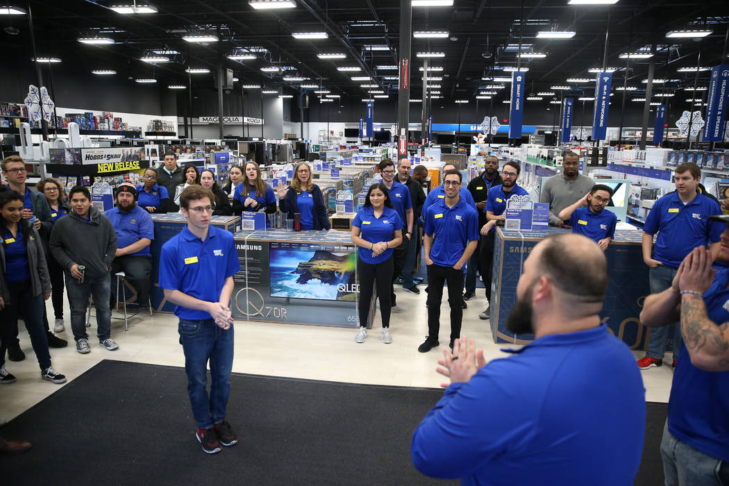 Best Buy employee prepare for Black Friday during an event lead by General Manager Anthony Saun ...
