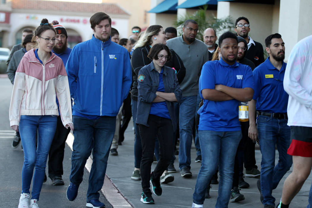 Best Buy employees prepare for Black Friday during a training event lead by General Manager Ant ...