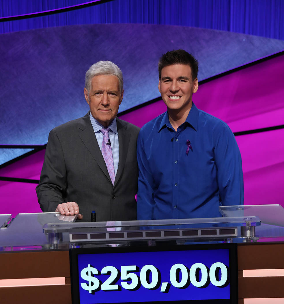 """Jeopardy!"" host Alex Trebek, left, and Las Vegan James Holzhauer are shown after the Tourn ..."