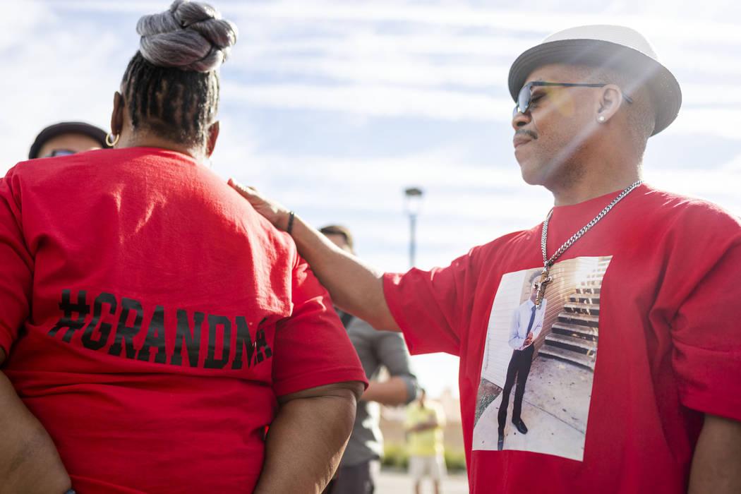 Sheilah Johnson, left, grandmother of homicide victim Jaejuan Williams, is comforted by husband ...