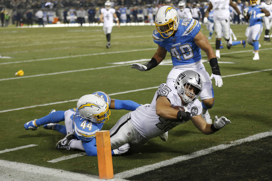 Oakland Raiders running back Alec Ingold (45) dives for the end zone to score past Los Angeles ...