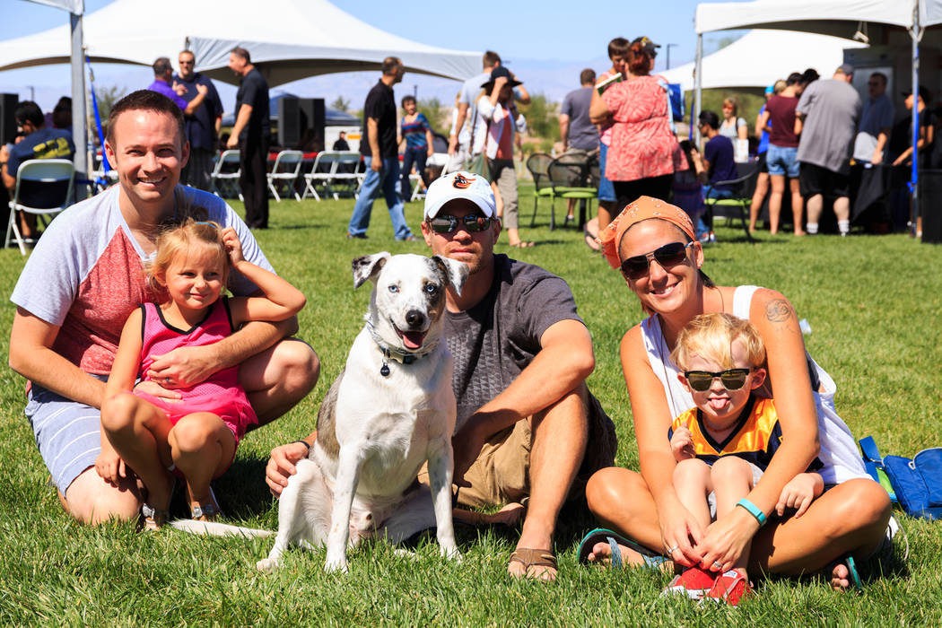 Leashed, four-legged friends are encouraged to enjoy the fenced-off Doggie Zone, hosted by Cade ...