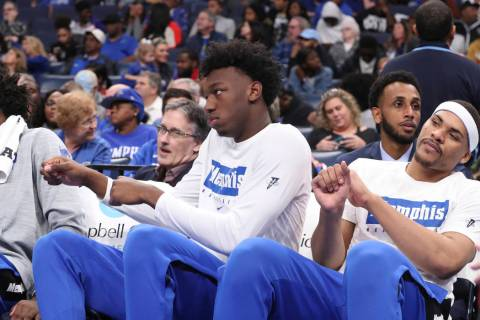 Memphis' James Wiseman, second from right, sits out the game along with Isaiah Stokes, right, i ...