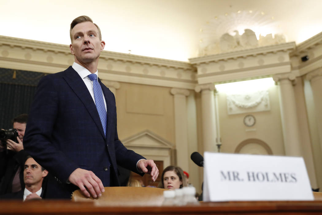 David Holmes, a U.S. diplomat in Ukraine, returns from a break to testify before the House Inte ...