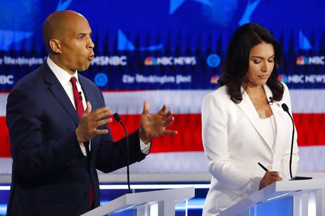 Democratic presidential candidate Sen. Cory Booker, D-N.J., speaks as Democratic presidential c ...