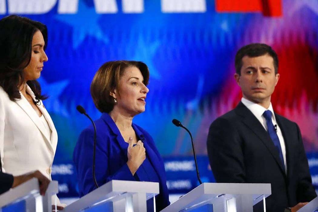 Democratic presidential candidate Sen. Amy Klobuchar, D-Minn., center speaks as Democratic pres ...