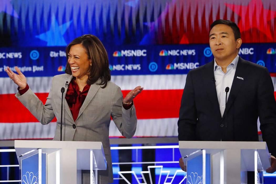Democratic presidential candidate Sen. Kamala Harris, D-Calif., reacts while speaking as Democr ...