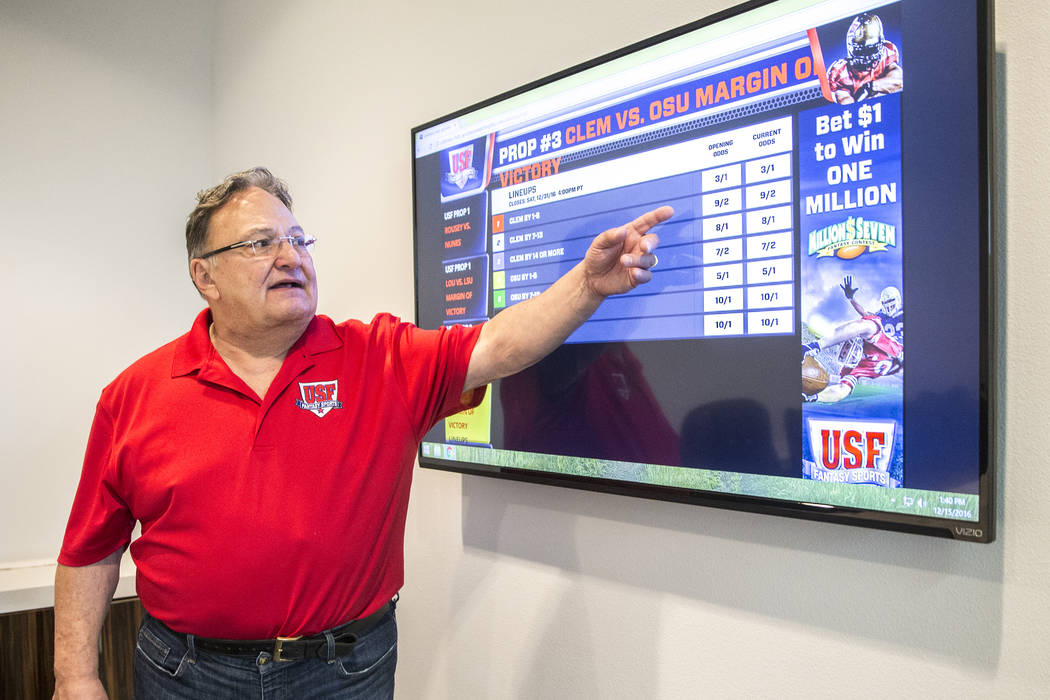 US Fantasy president Vic Salerno explains the function of a video display board showing current ...