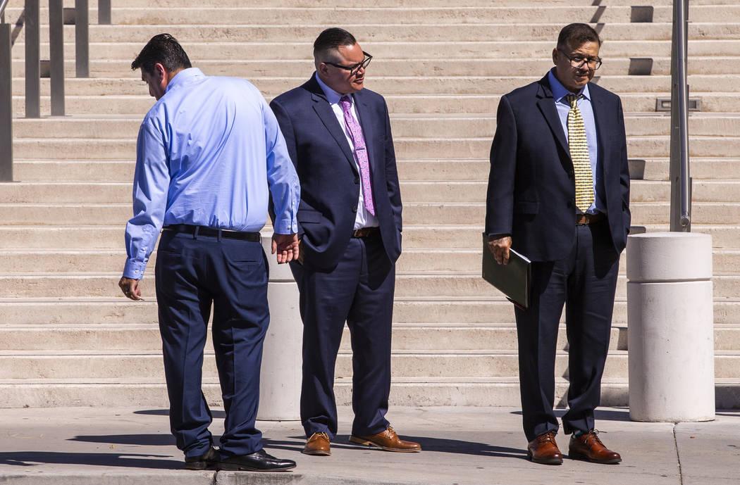 Defendants Bradley Campos, left, Diego Garcia and Cesar Morales depart the Lloyd D. George Cour ...