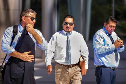 Counselor Mark Fleming, left, walks out with defendant Albert Lopez past defendant Bradley Camp ...