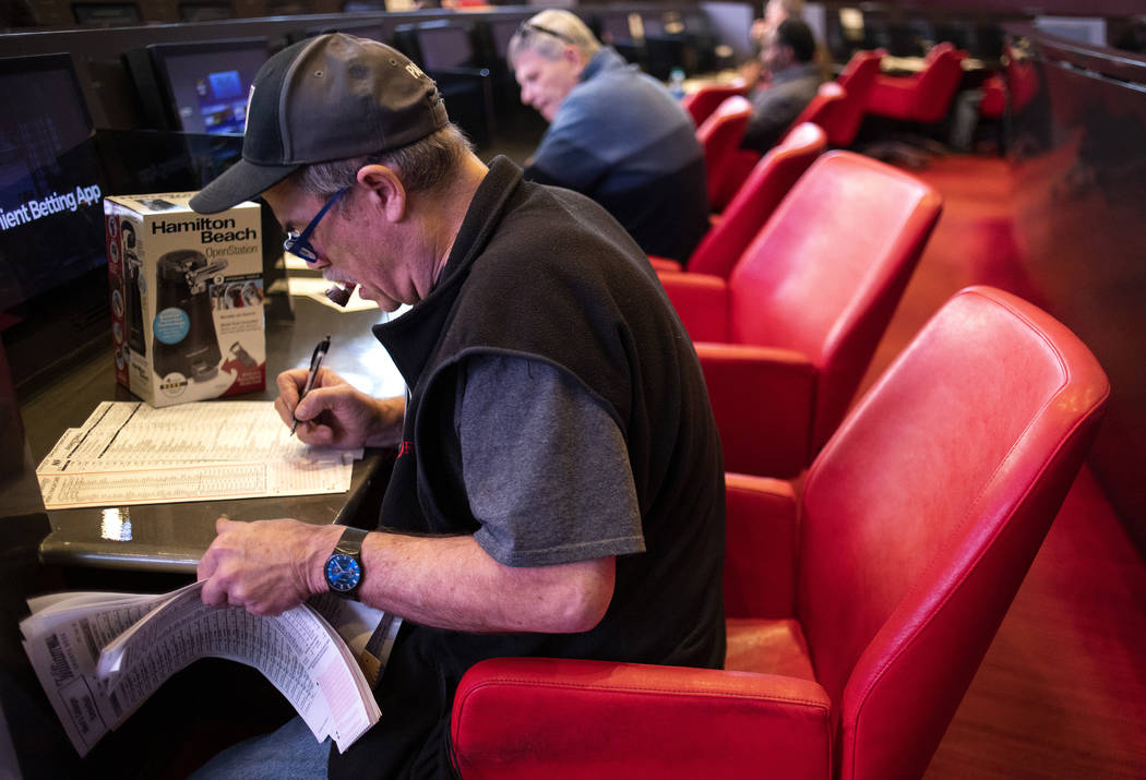 Tom Schiffhauer of Las Vegas places a bet at the Palms sportsbook on Thursday, Nov. 21, 2019, i ...