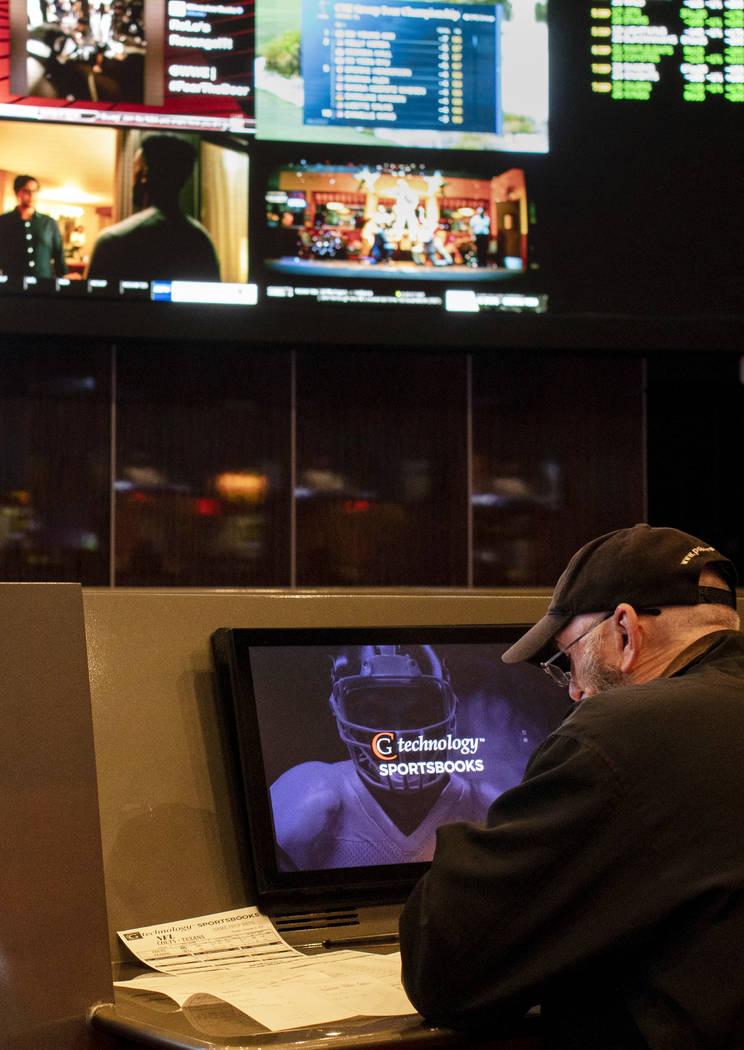 A gambler at the Palms sportsbook on Thursday, Nov. 21, 2019, in Las Vegas. (Ellen Schmidt/Las ...