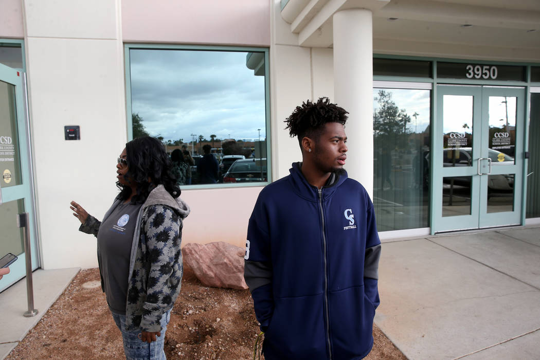 Canyon Springs quarterback DJ Lewis-Bealer and his mother Shalicia Lewis talk to a reporter out ...