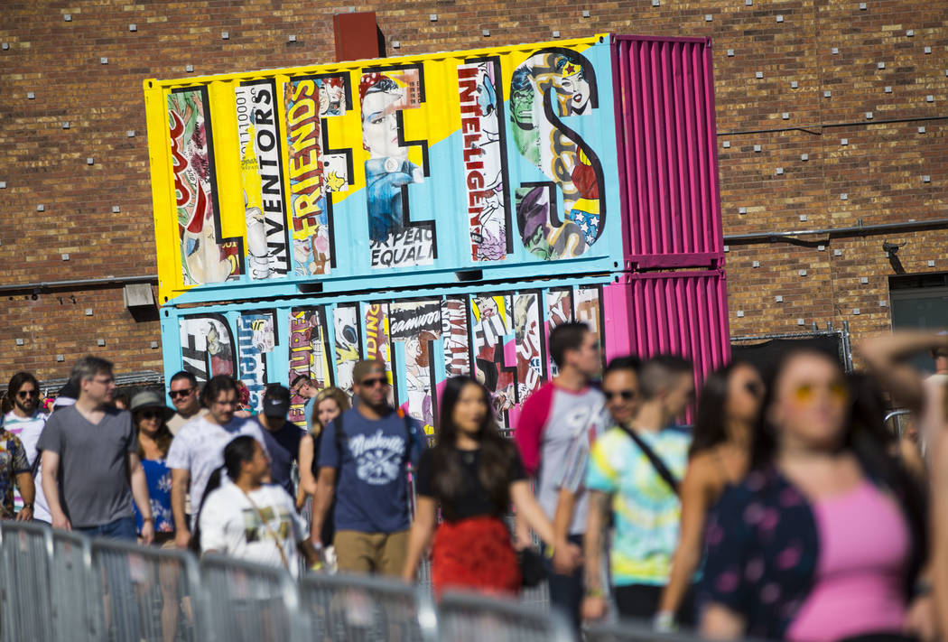 Attendees arrive for day 2 of the Life is Beautiful festival in downtown Las Vegas on Saturday, ...