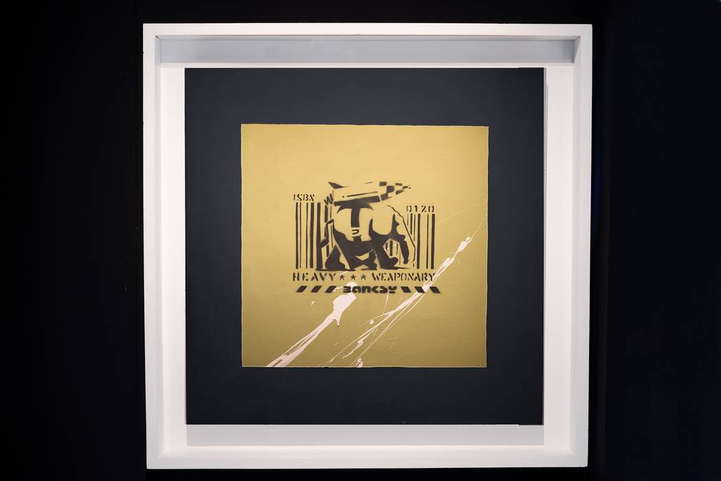 """""""Heavy Weaponry"""" is one of the Bansky works in the exhibit. (Genius or Vandal: Banksy Exhibition)"""