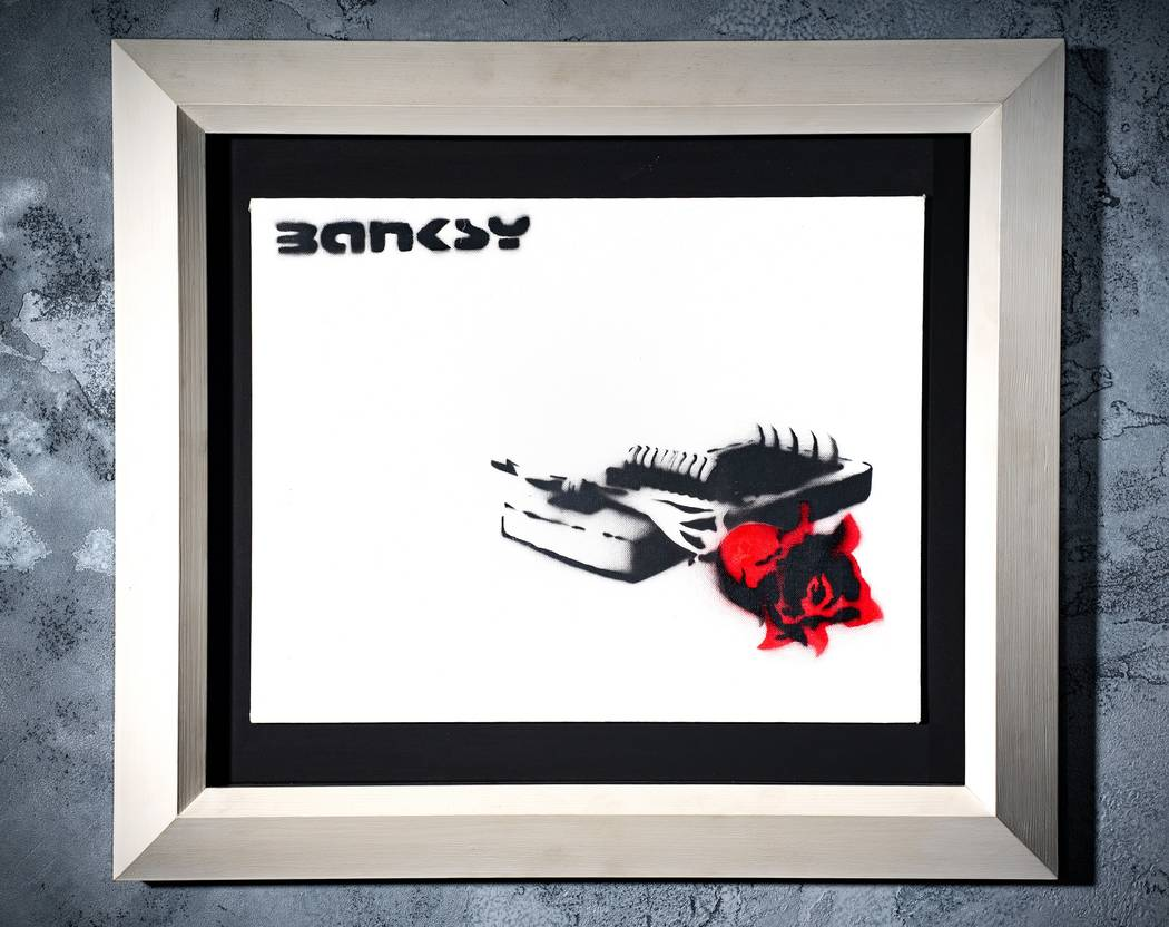 """""""Rose Trap"""" is one of the Bansky works in the exhibit. (Genius or Vandal: Banksy Exhibition)"""