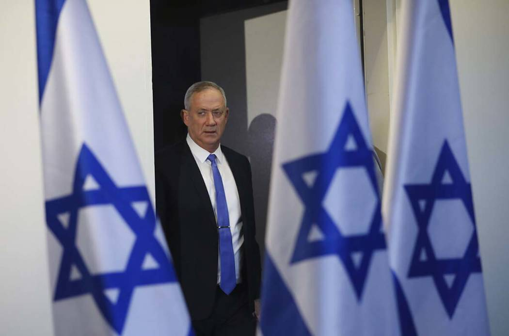 Blue and White party leader Benny Gantz arrives to address media in Tel Aviv,Israel. Wednesday, ...