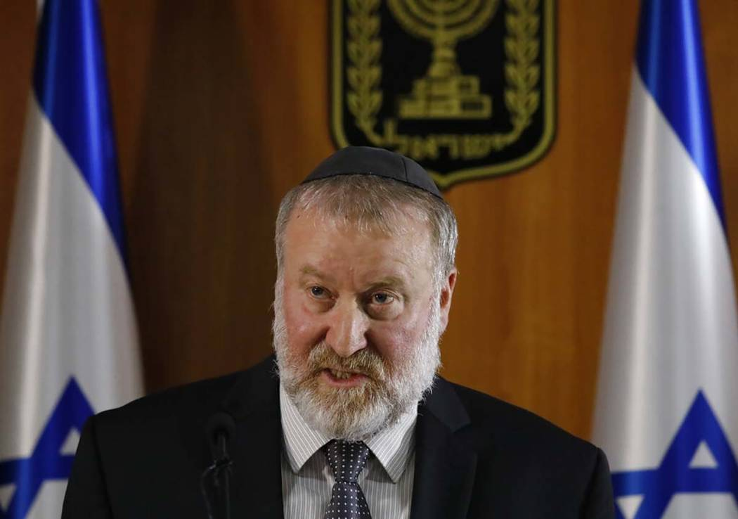 Israel's Attorney General Avichai Mandelblit reads statement for media in Jerusalem, Thursday, ...