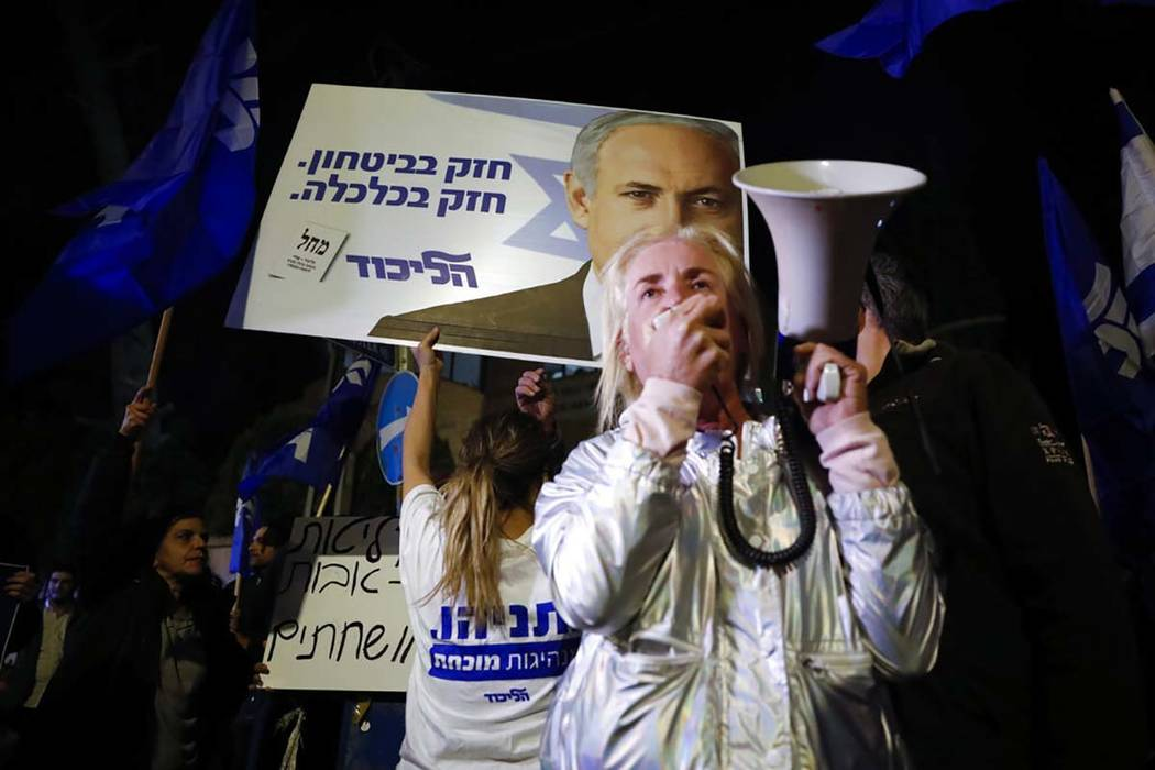Supporters of Israeli Prime Minister Benjamin Netanyahu gather outside his residence in Jerusal ...