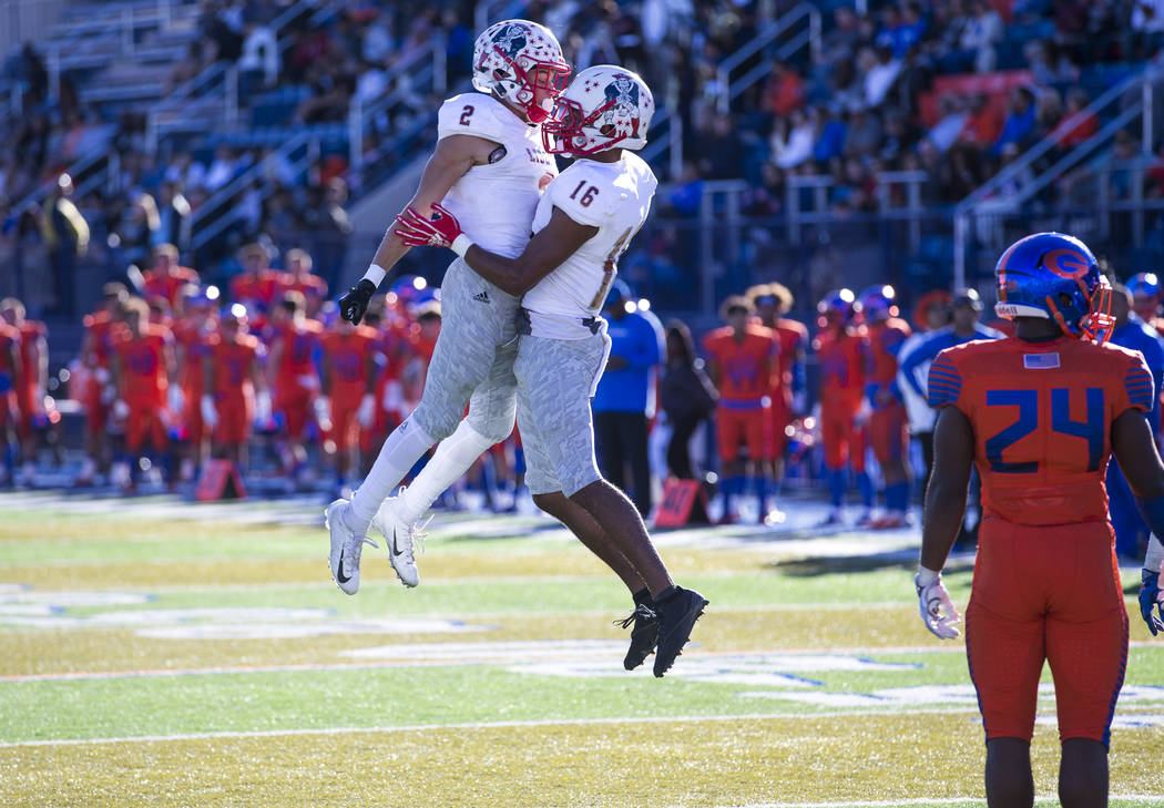 Liberty wide receiver Maurice Hampton (16) celebrates with David Elder (2) after scoring a touc ...