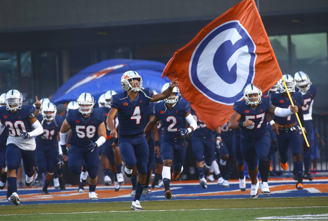 Bishop Gorman's Rome Odunze (4) points to the crowd as players enter the field before taking on ...