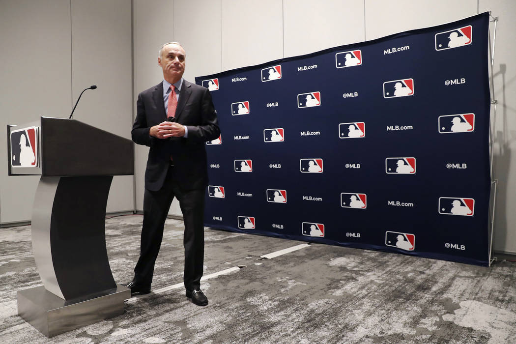 Baseball commissioner Rob Manfred steps away from the podium after speaking to the media at the ...
