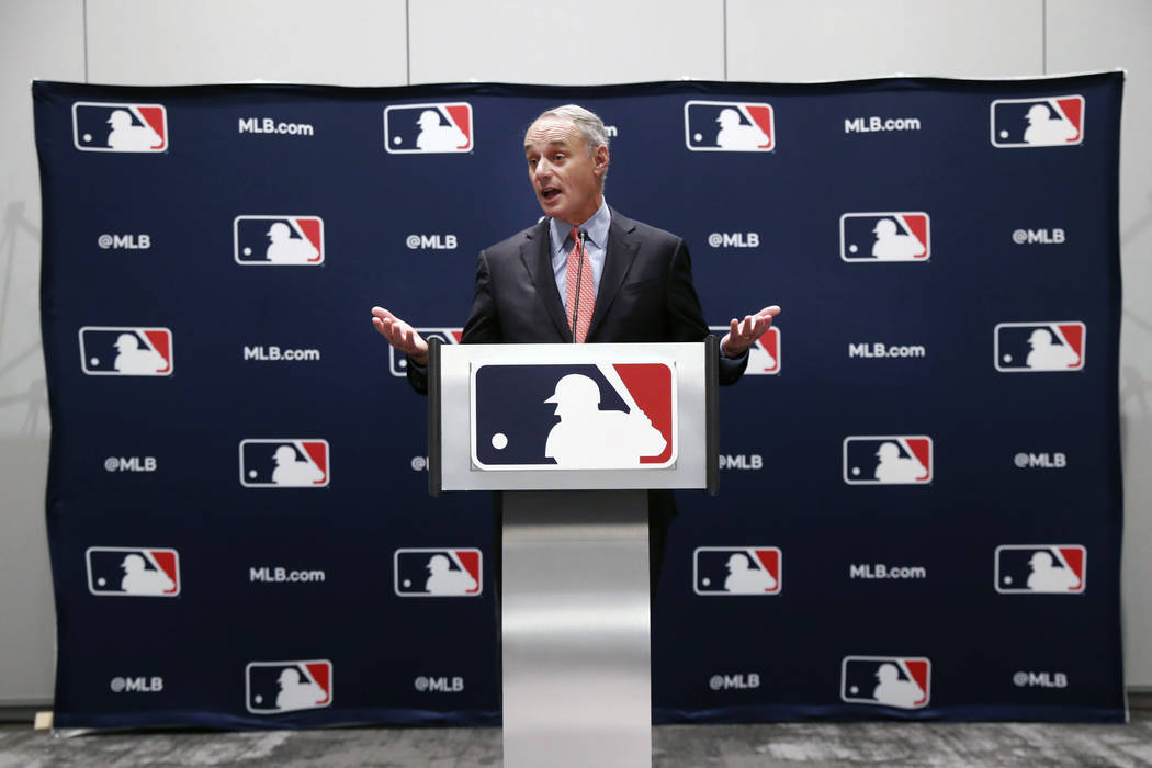 Baseball commissioner Rob Manfred speaks to the media at the owners meeting in Arlington, Texas ...