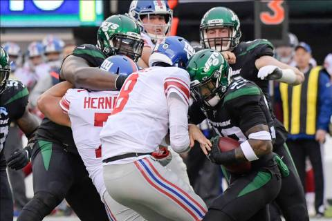 New York Jets strong safety Jamal Adams, right, strips the ball from New York Giants quarterbac ...