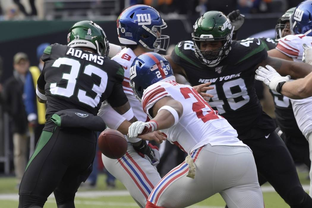 New York Jets strong safety Jamal Adams (33) knocks the ball away from New York Giants quarterb ...