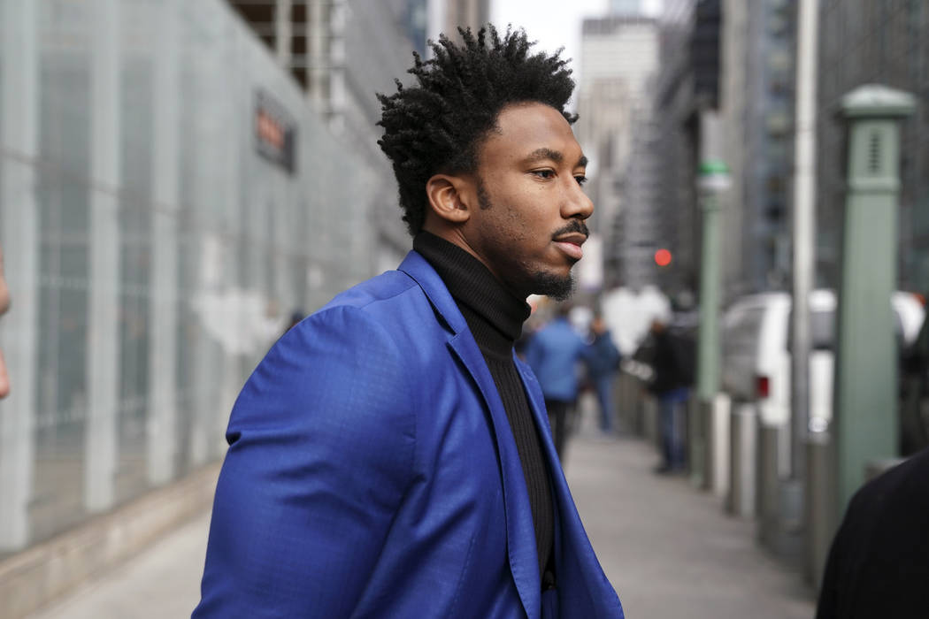 Cleveland Browns star defensive end Myles Garrett leaves an office building in New York, Wednes ...