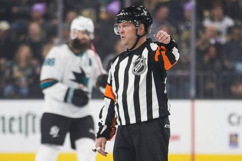 Referee Dan O'Halloran works the Vegas Golden Knights, San Jose Sharks NHL hockey game on Thurs ...