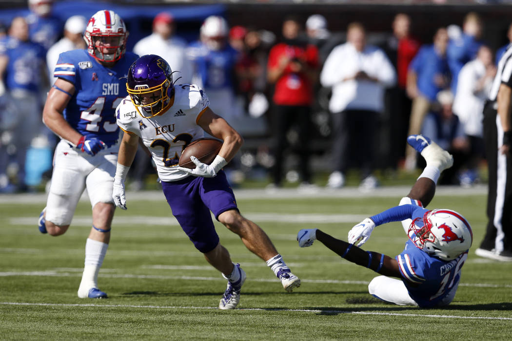 East Carolina receiver Tyler Snead (22) advances the ball after SMU safety Chace Cromartie, rig ...