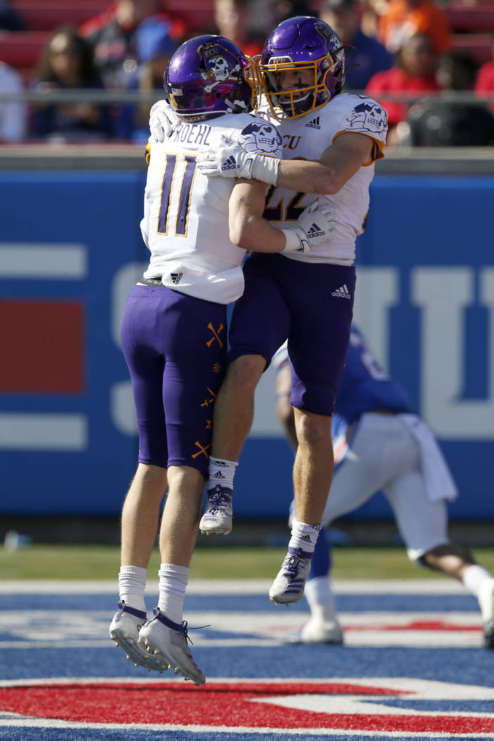 East Carolina receivers Tyler Snead, right, and Blake Proehl (11) celebrate after Snead caught ...