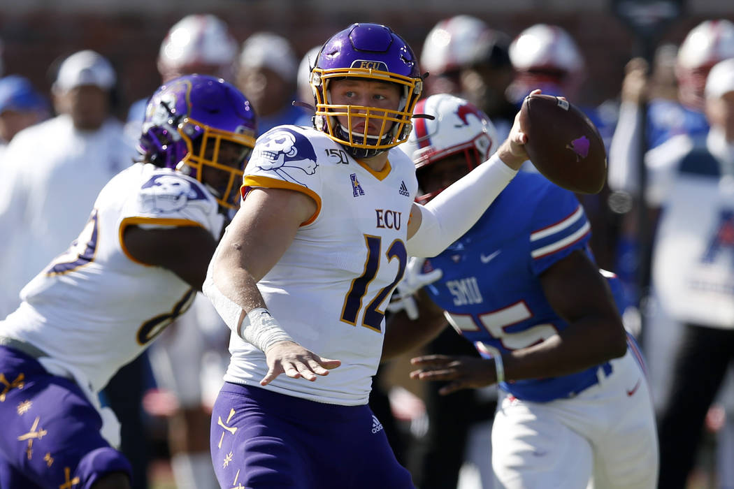 East Carolina quarterback Holton Ahlers attempts a pass during the second half of an NCAA colle ...