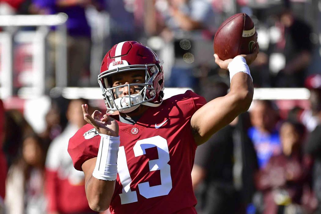Alabama quarterback Tua Tagovailoa (13) warms up before an NCAA football game against LSU, Satu ...