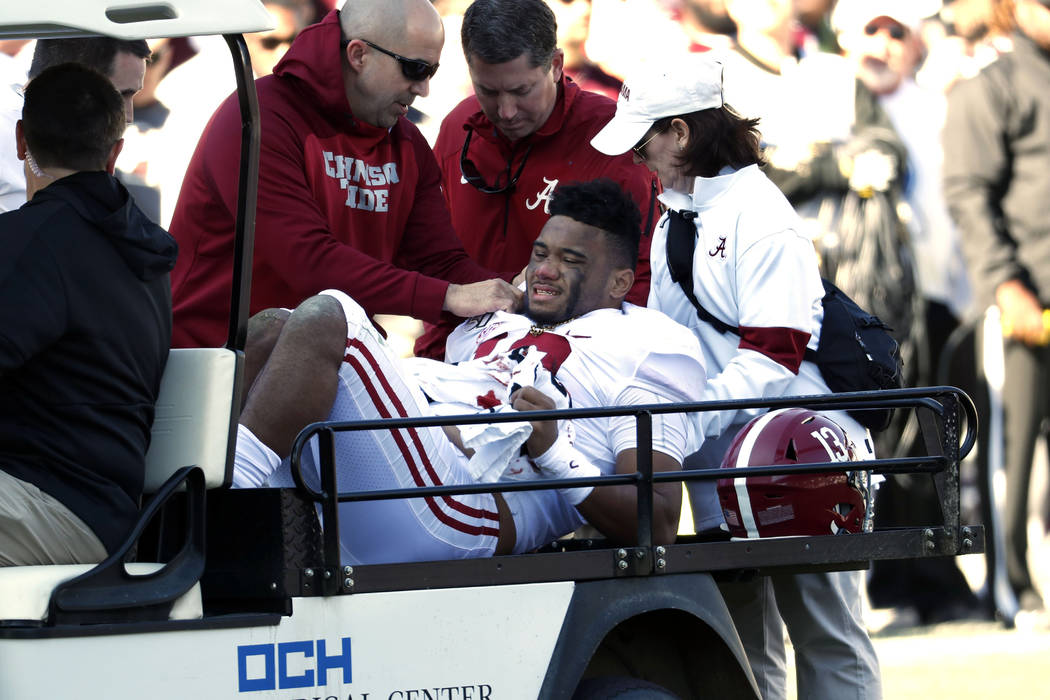 Alabama quarterback Tua Tagovailoa (13) is carted off the field after getting injured in the fi ...