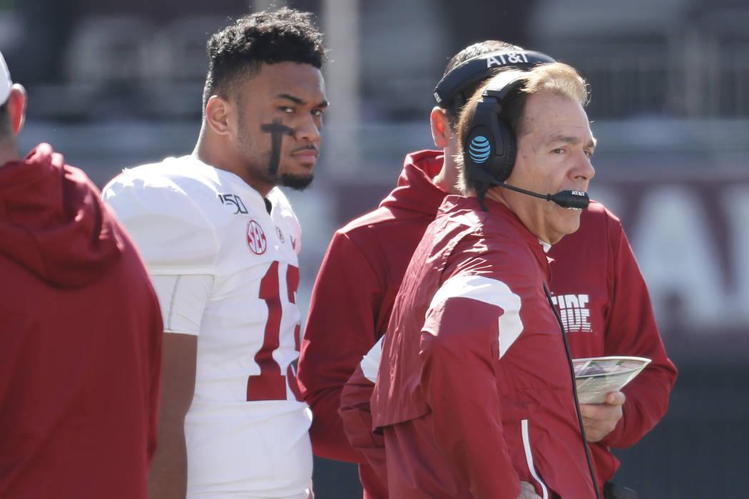 Alabama quarterback Tua Tagovailoa (13) listens to instructions from head coach Nick Saban duri ...
