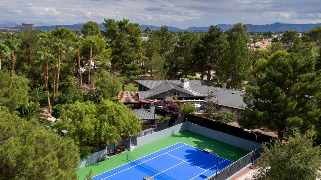 A two-home historical compound in the historic Winchester District features a tennis court. (Si ...