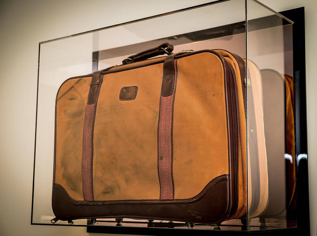This framed brown suitcase is a reminder of when Saville Kellner came to the U.S. from South Af ...