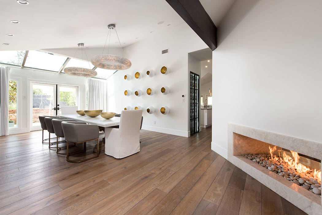 The formal dining room features a modern-design fireplace and opens to the patio. (Simply Vegas)