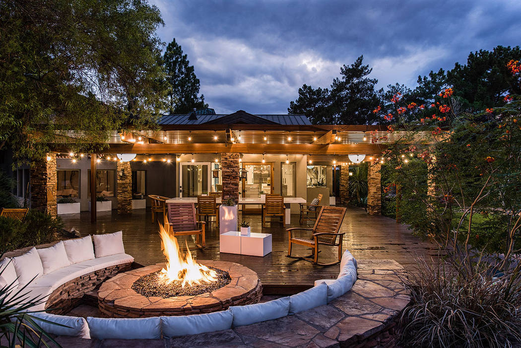 The main house's patio features a large fire pit. (Simply Vegas)