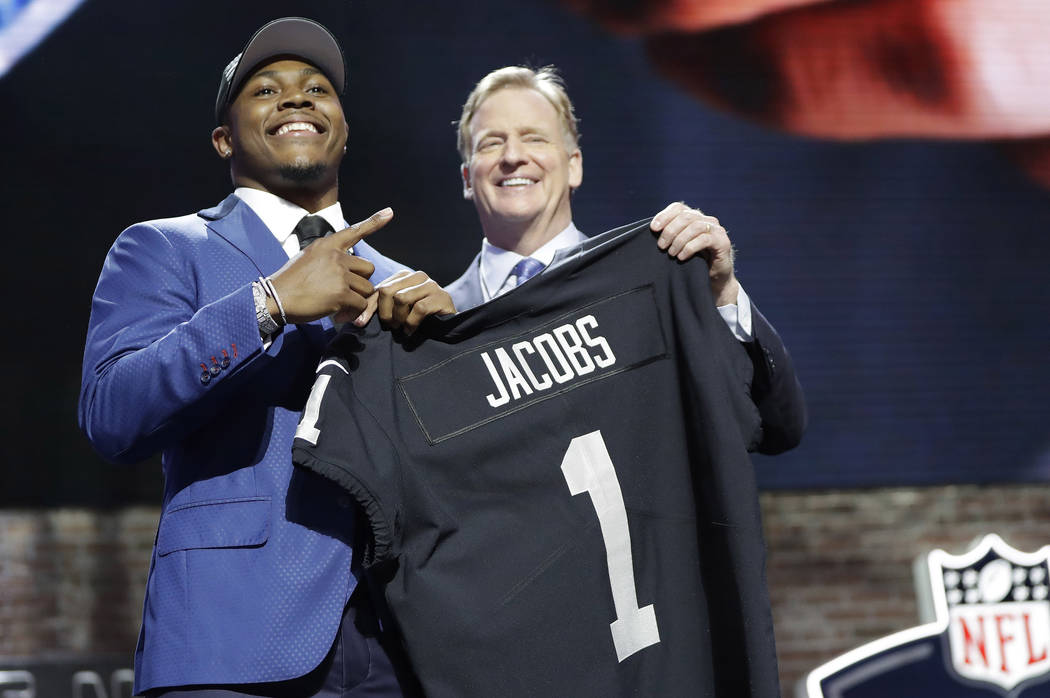 Alabama running back Josh Jacobs poses with NFL Commissioner Roger Goodell after the Oakland Ra ...