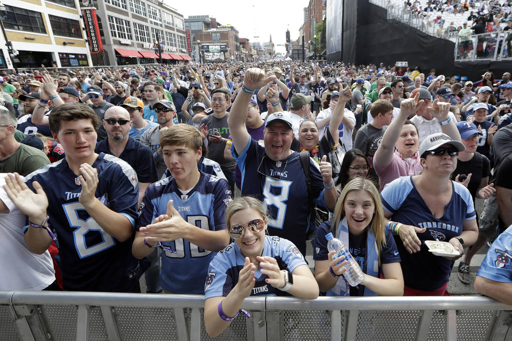 Fans attend the final day of the NFL football draft Saturday, April 27, 2019, in Nashville, Ten ...