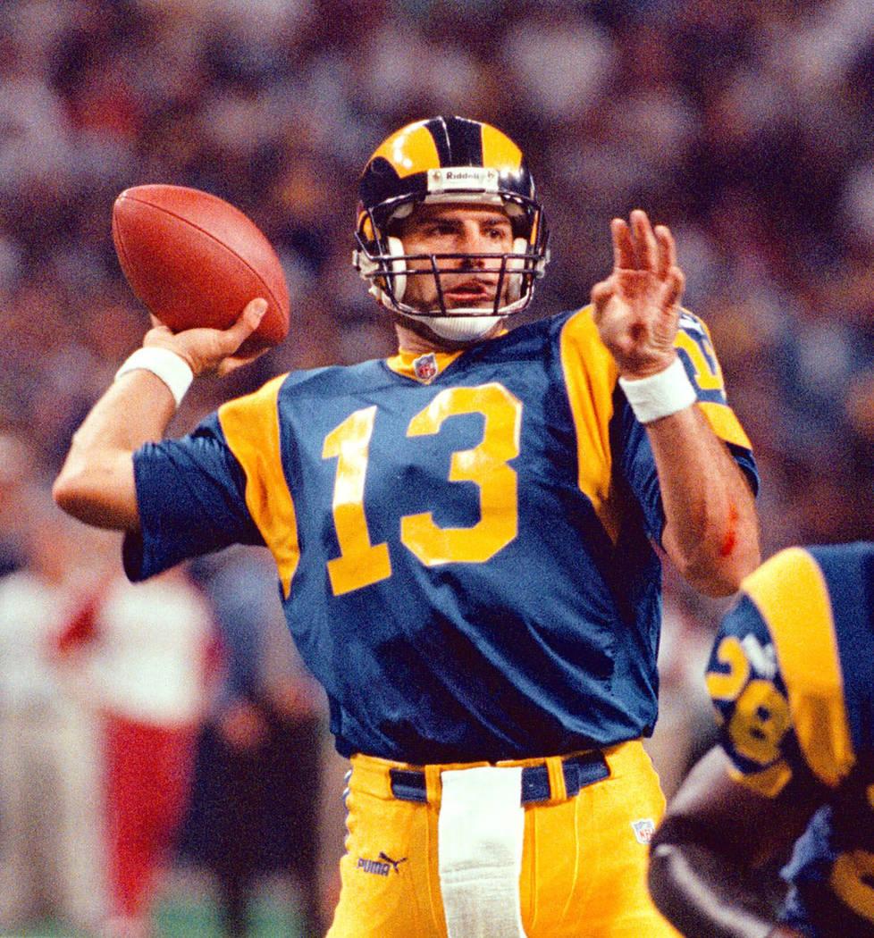 St. Louis Rams' quarterback Kurt Warner (13) tosses his third touchdown pass during the first q ...