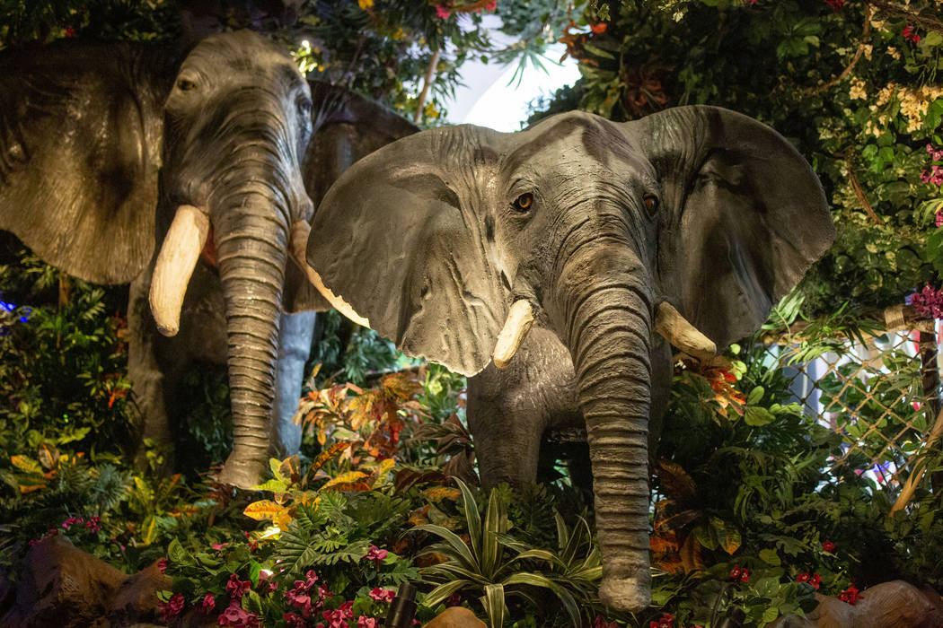 Mechanical elephants act as decoration in the Rainforest Cafe in the Miracle Mile Shops on the ...
