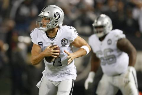 Oakland Raiders quarterback Derek Carr (4) rolls out to pass against the Los Angeles Chargers d ...