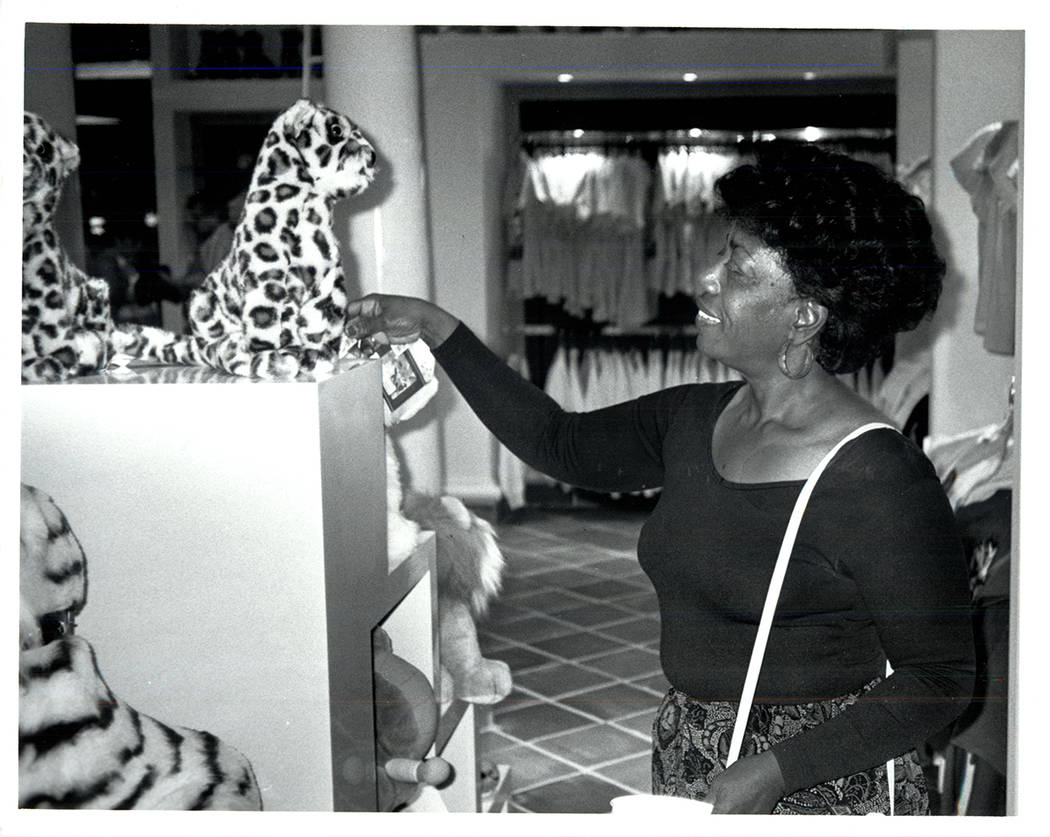 A visitor admires a stuffed tiger in gift shop at the Mirage on Nov. 22, 1989. (Wayne Kodey / L ...
