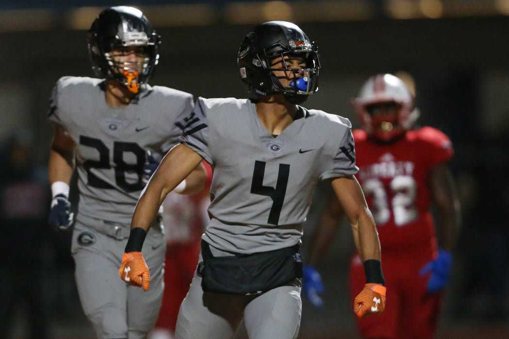 Bishop Gorman Rome Odunze (4) celebrates a touchdown catch, with Izaiah Halmos (28), in the fir ...
