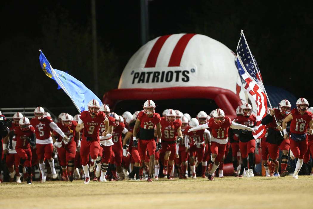 Liberty takes the field for their football playoff game against Bishop Gorman at Liberty High S ...